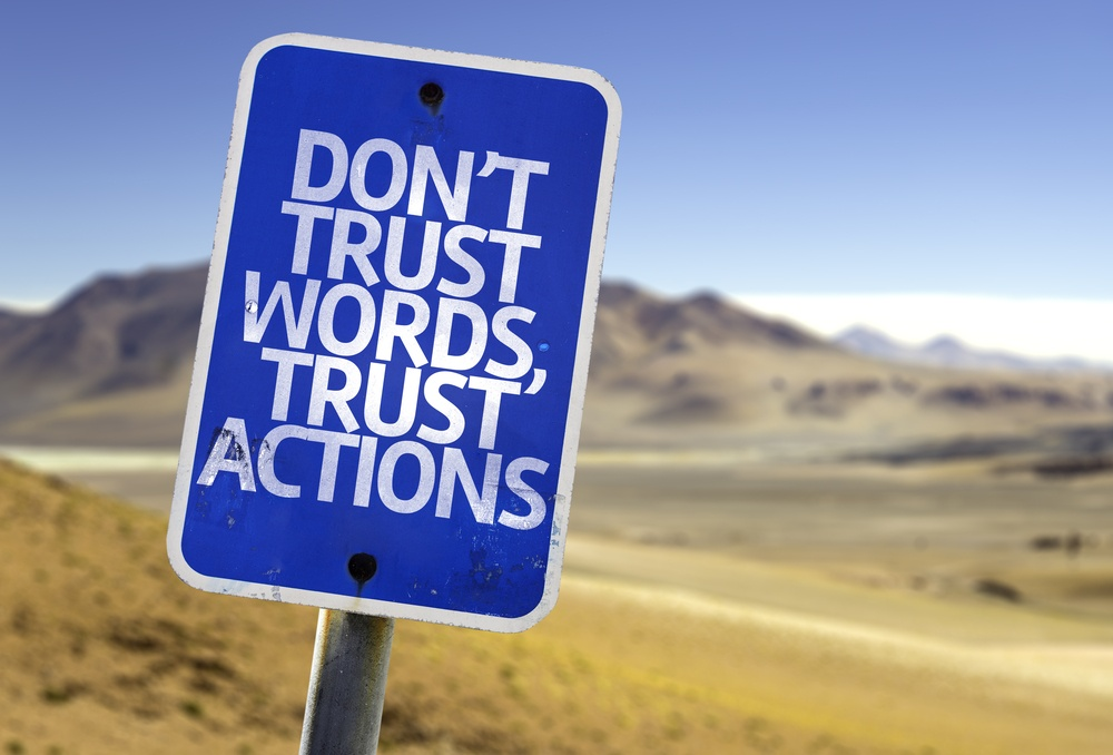 Don't Trust Words, Trust Actions sign - Lone Armadillo